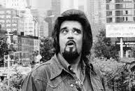 Wolfman Jack looking surprised in an outdoor black and white portrait.